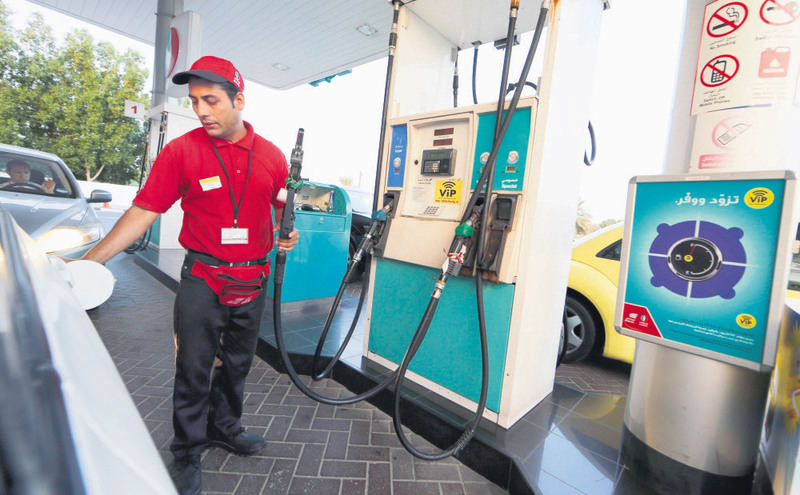A man fills a car with petrol at a petrol station in Dubai on Tuesday.