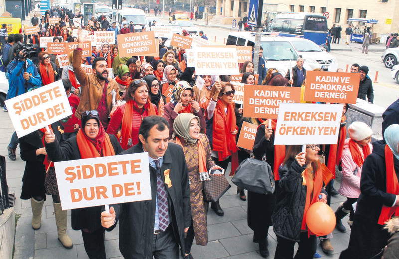 Activists in the eastern city of Erzurum staged a demonstration yesterday carrying banners reading ,Stop violence, and ,Be a man and beat your anger.,