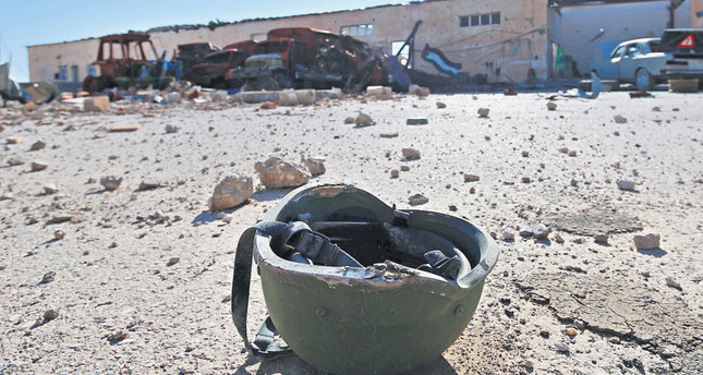 A helmet belonging to a DAESH militant is seen on the ground after the Democratic Forces of Syria took control of the base in the town of al-Melabiyyah, Syria