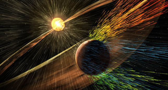 This image made available by NASA on Thursday, Nov. 5, 2015 shows an artist's rendering of a solar storm hitting the planet Mars. (AP Photo)