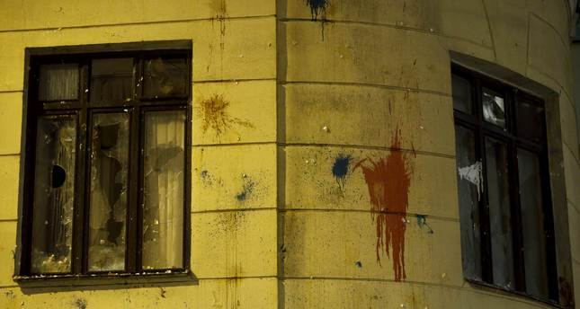 The windows of the Turkish embassy broken by protesters in reaction after a Russian war plane was shot down by Turkey, are pictured in Moscow, Russia November 25, 2015. REUTERS Photo