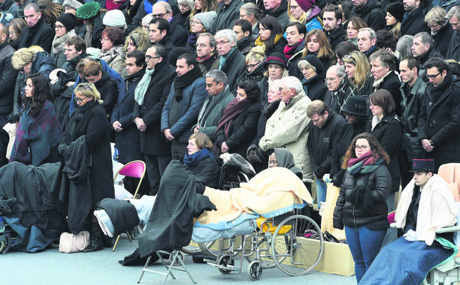 People wounded in the Paris terror attacks and relatives of victims attend the national and republican tribute, a solemn ceremony in honor of the 130 people who were killed by DAESH two weeks ago. (AP Photo)
