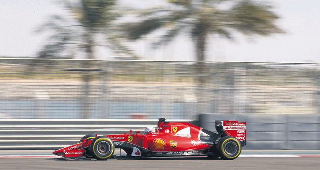 Ferrari driver Sebastian Vettel of Germany steers his car during the first training session at the Yas Marina racetrack in Abu Dhabi, United Arab Emirates on Friday.