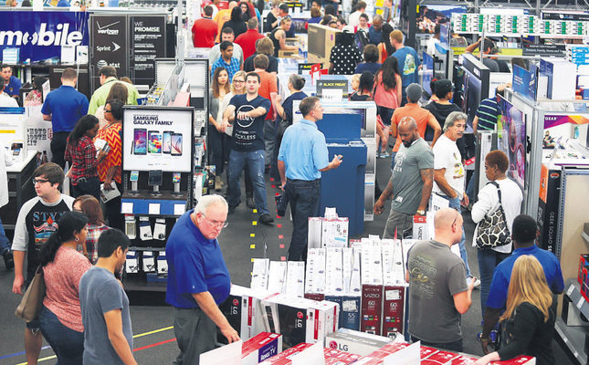 People look at merchandise while holiday shopping at Best Buy on Thursday in Panama City, FL. (AP Photo)