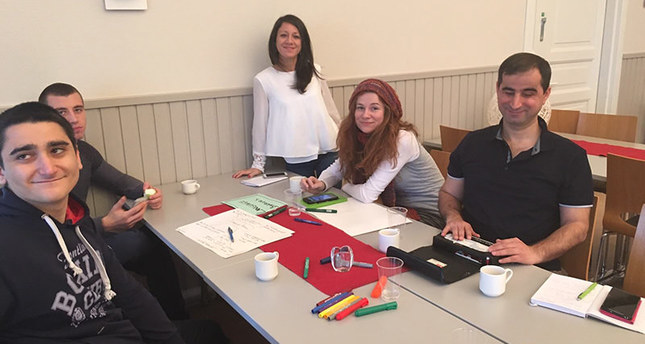 Kenan Önalan (right) with participants of the project in Finland