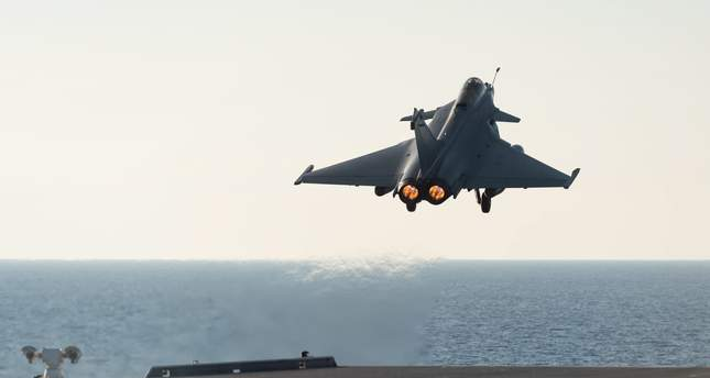 French military jet part of the Mission Arromanches 2 in Iraq against the Daesh group taking off from the Charles de Gaulle aircraft carrier, deployed in the Mediterranean Sea, 23 November 2015. EPA Photo