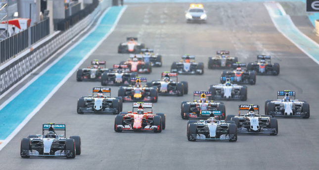 Mercedes Formula One driver Nico Rosberg of Germany leads the pack as they approach the first turn during the Abu Dhabi F1 Grand Prix at the Yas Marina circuit in Abu Dhabi on Sunday.
