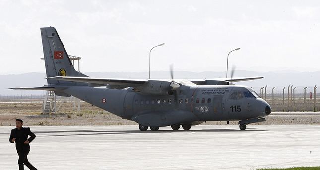 A Turkish Air Force plane arrives for taking on board the Russian pilot who was killed in the downing of a fighter jet in Syria, at Hatay airport (EPA Photo)