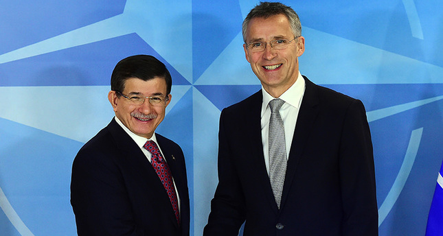 Prime Minister Ahmet Davutoglu (L) meets with NATO Secretary General Jens Stoltenberg at the NATO headquarters on November 30, 2015 in Brussels (AFP Photo)