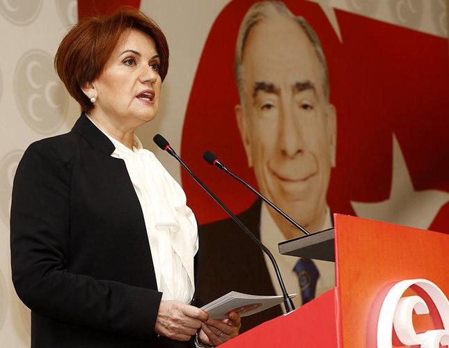 The portrait of Alparslan Türkeş, founding chairman of the MHP, is seen in the background while Akşener speaks. AA Photo