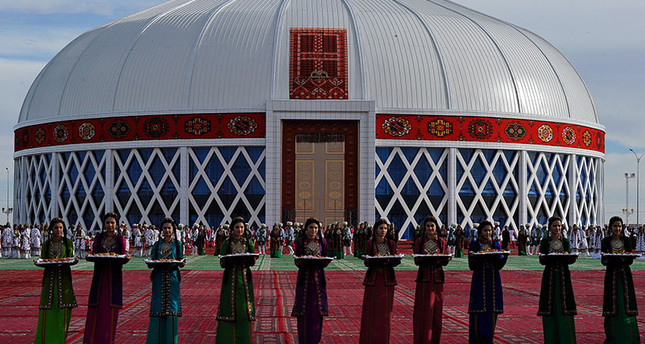 Artists perform during the ceremony for the presentation of the world's biggest yurt (traditional dwelling of nomadic Turkmen people) (AFP Photo)