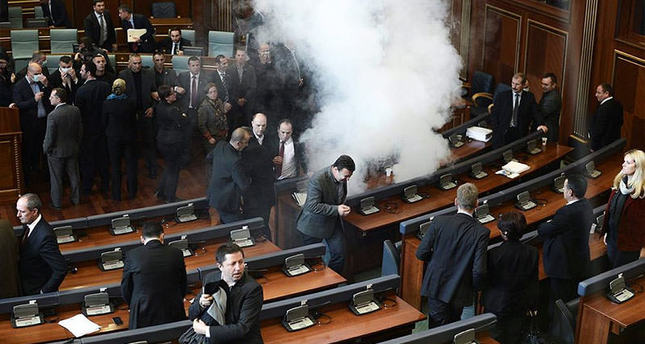 Opposition lawmakers throw tear gas during a session of Kosovo's parliament in Pristina, Kosovo, 30 November 2015 (EPA photo)