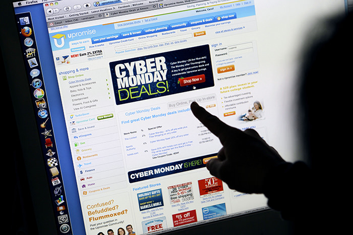 a consumer looks at Cyber Monday sales on her computer at her home in Palo Alto, Calif. (AP Photo)