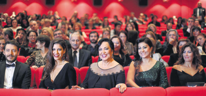 Legendary Turkish actress and director Tu00fcrkan u015eoray (center) attended the gala with her daughter Yau011fmur u00dcnal (L) and the film crew of ,Uzaklarda Arama.,