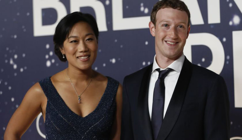 Mark Zuckerberg (R), founder and CEO of Facebook, and wife Priscilla Chan arrive on the red carpet during the 2nd annual Breakthrough Prize Award in California. (REUTERS Photo)