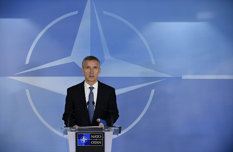 NATO Secretary General Jens Stoltenberg gestures as he speaks during a press conference before a Foreign Affairs meeting at the NATO headquarters in Brussels (AFP Photo)