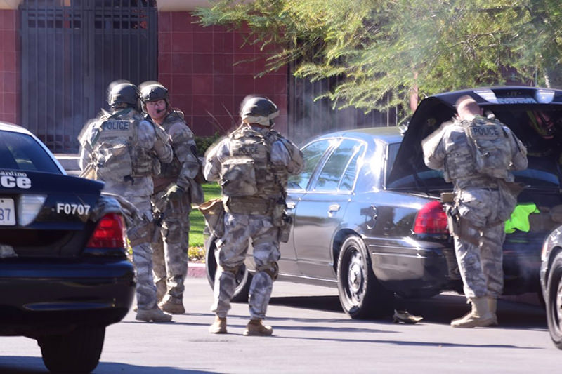 A swat team arrives at the scene of a shooting in San Bernardino, Calif. on Wednesday, Dec. 2, 2015 (AP Photo)