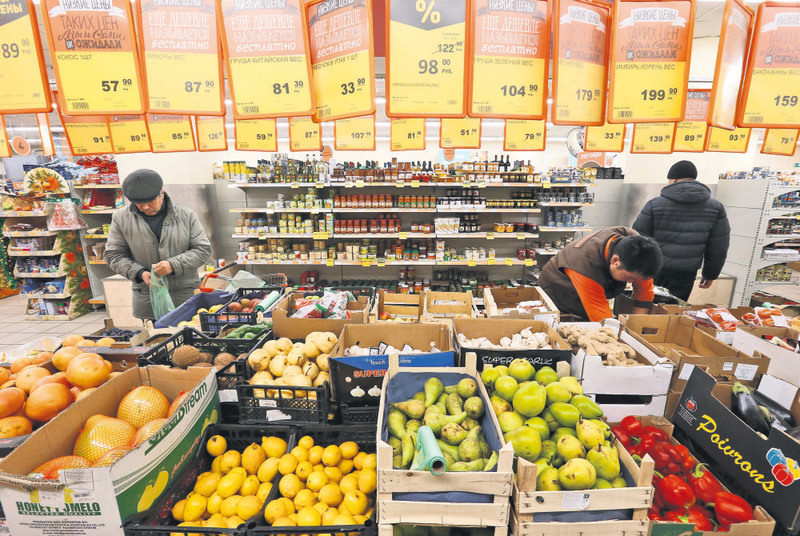 Fruits, vegetables and other products are seen on sale at a grocery store of the food retailer Dixy in Moscow. Russia bans Turkish food exports to revenge downed warplane by Turkey last week.