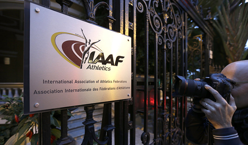 In this Nov.13, 2015 file photo, a photographer pictures the logo at the IAAF (International Amateur Athletic Federation) headquarters in Monaco (AP Photo)