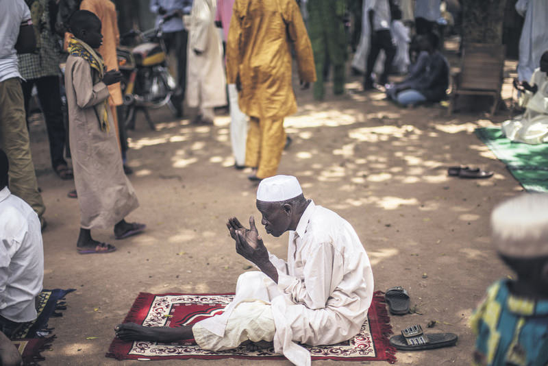A Muslim prays during the Friday noon prayer.