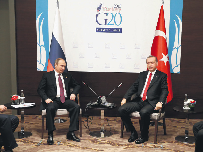 Russian President Putin (L) and his Turkish counterpart Erdou011fan pose for the media before their talks during the G20 Summit in Antalya on Nov. 16.