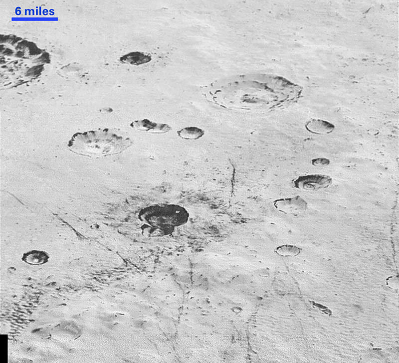 This handout picture obtained from NASA on December 5, 2015 shows an image taken from NASA's New Horizons spacecraft showing new details of Plutou2019s rugged, icy cratered plains (AFP photo)
