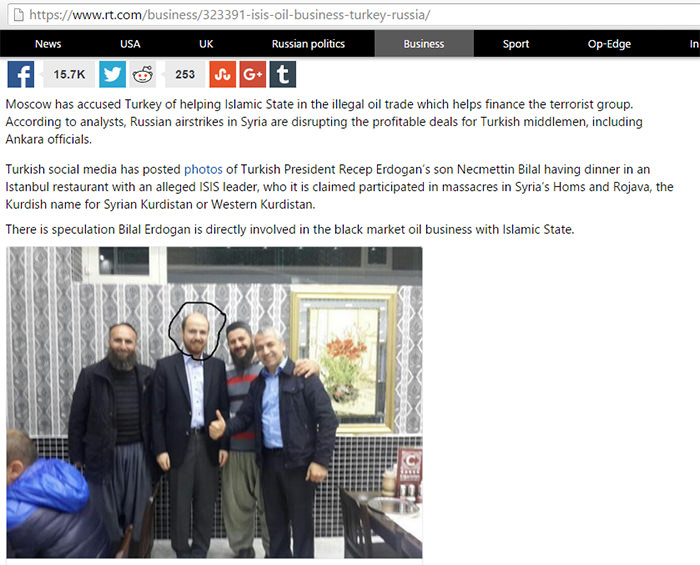 A screenshot of Russia Today's article showing Bilal Erdoğan in a picture with Kember brothers
