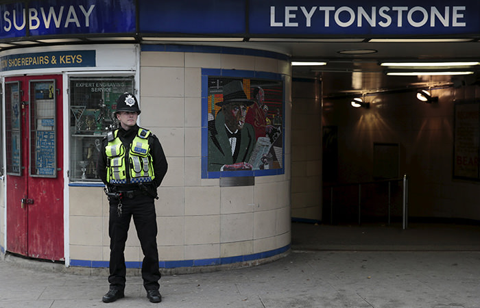 A police officer patrols outside Leytonstone Underground station in east London, Britain December 6, 2015 (Reuters Photo)