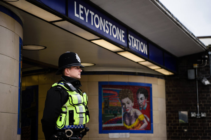 A police officer stands guard outside Leytonstone station Dec 6, 2015, a day after 3 were stabbed in a ,terrorist incident,.  (AFP Photo)