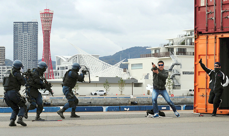 In this Thursday, Nov. 19, 2015 photo, riot police of Hyogo Prefectural Police, left, take positions against ,armed terrorists, performed by police officers during an anti-terror drill at a port in Kobe, western Japan (AP Photo)