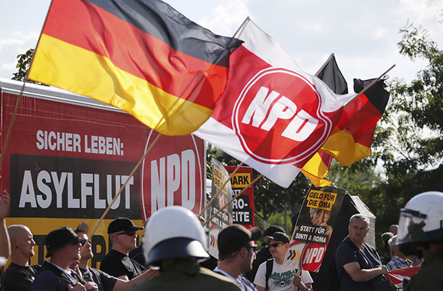 Far-right National Democratic Party NPD supporters protesting against a refugee asylum in the Hellersdorf district of Berlin, August 24, 2013 Reuters Photo