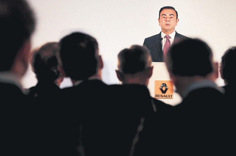 Carlos Ghosn, CEO of the Renault-Nissan Alliance, speaks during Renault's 2014 annual results presentation at its headquarters in Boulogne-Billancourt, near Paris.