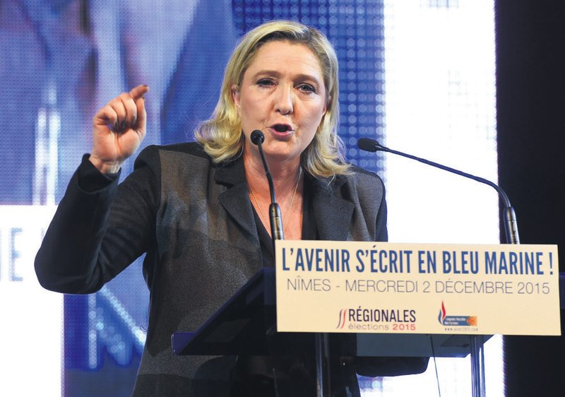 President of the French far-right Front National (FN) party, Marine Le Pen delivers a speech during a campaign meeting in Nimes