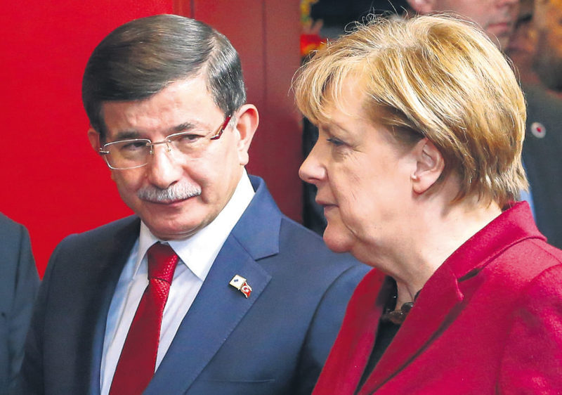 Prime Minister Davutou011flu (L) with German Chancellor Merkel at the Turkish-EU summit on Nov. 29 in Brussels where the two sides reached an agreement to collaborate in resolving the refugee crisis.