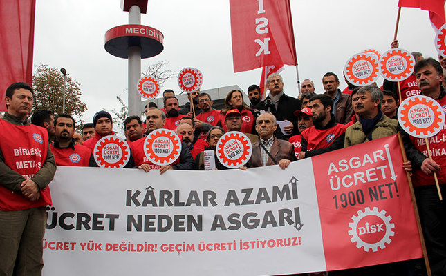 Profits are maximum, so why the wages are minimum? the banner reads. (AA Photo)