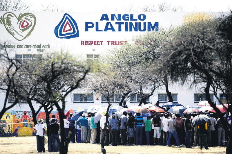A picture taken on Oct. 5, 2012, shows striking mine workers gathering outside the Anglo American Platinum (Amplats) Mine in Rustenburg, South Africa.