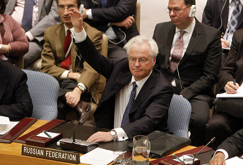 Russian representative Vitaly Churkin vetoes a draft resolution backing an Arab League call for Syrian President Bashar Assad to step down during a meeting of the United Nations Security Council at United Nations (AP Photo)