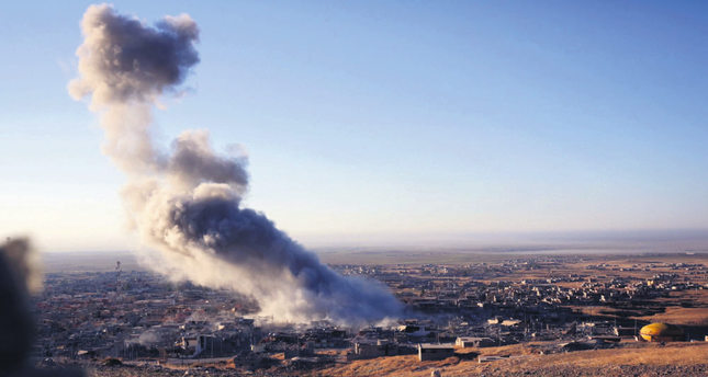 Smoke rises from the Northern Iraqi town of Sinjar, which DAESH militants occupied more than a year ago, killing and enslaving thousands of the people.