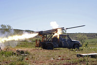 Rebel fighters from the Ahrar al-Sham fire grad rockets from Idlib countryside towards forces loyal to Syria's Bashar Assad (Reuters Photo)