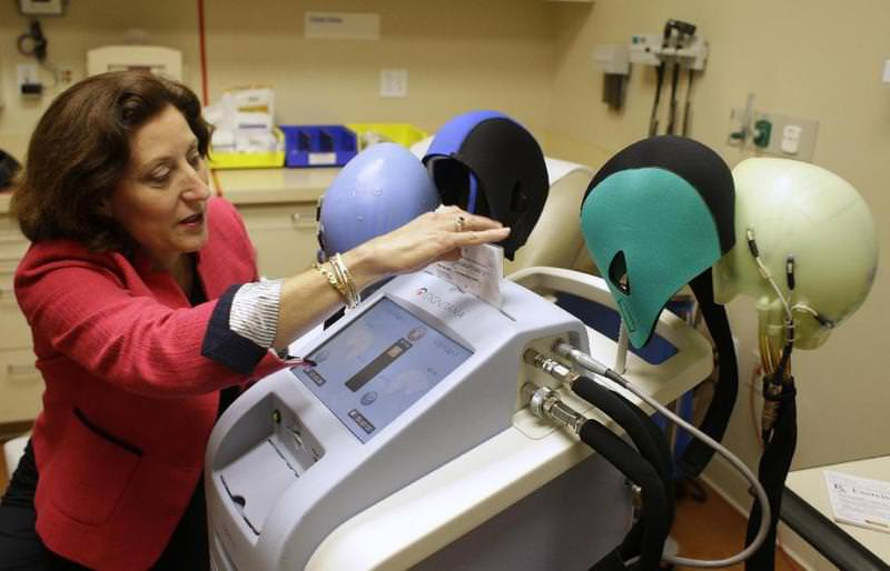 Hair loss is one of the most despised side effects of chemotherapy, and now breast cancer patients are getting a new way to save their locks. (AP Photo)