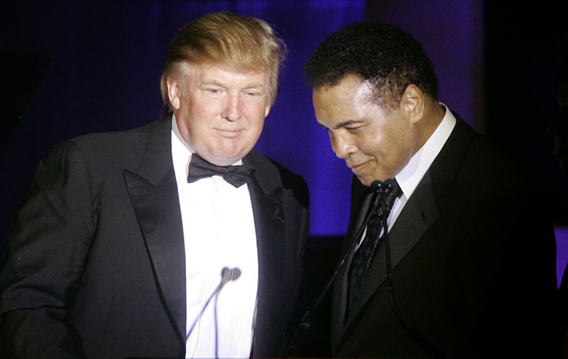 n this March 24, 2007, file photo, Donald Trump, left, accepts his Muhammad Ali award from Ali at Muhammad Ali's Celebrity Fight Night XIII in Phoenix, Ariz (AP Photo)
