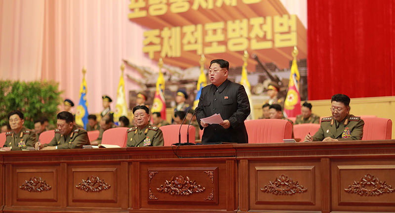 This picture released from North Korea's official Korean Central News Agency (KCNA) on December 5, 2015 shows North Korean leader Kim Jong-Un (front 2nd R) (AFP Photo)