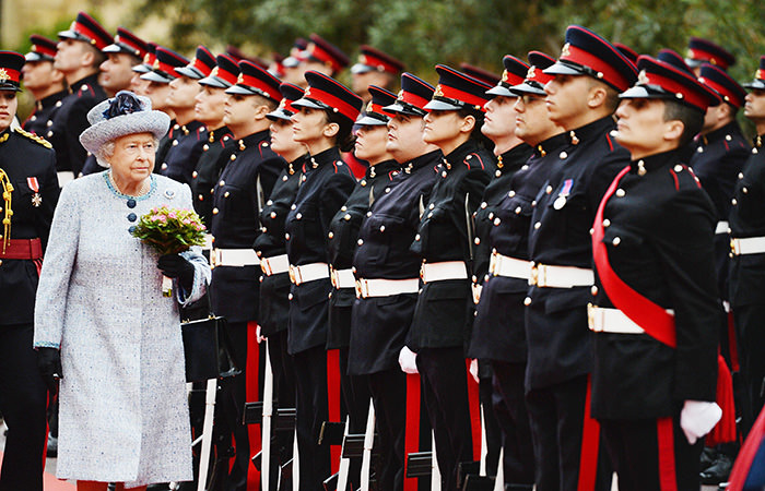 Britain's Queen Elizabeth II inspects a guard of honour in the grounds of the San Anton Palace, in Malta 26 November 2015 (EPA Photo)