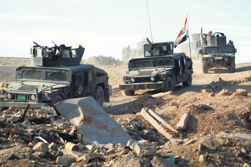 Iraqi counter-terrorism forces drive in the Tameem district of Ramadi, a large city on the Euphrates 100 kilometers west of Baghdad on Dec. 9.