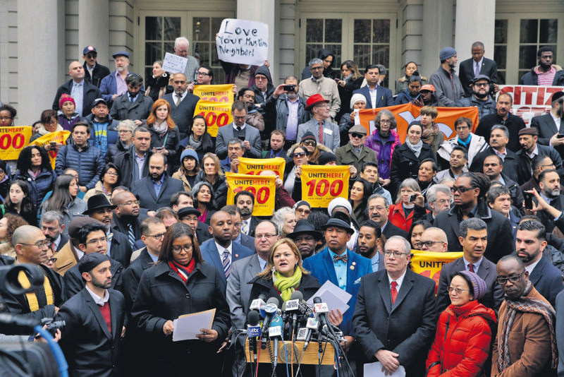 New York City Council Speaker Melissa Mark-Viverito, center, speaks during an interfaith rally at New York's City Hall in response to Trump's call to block Muslims from entering the United States.