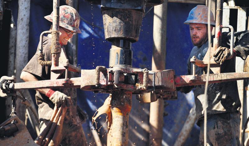 Oil field workers drill into the Gypsum Hills near Medicine Lodge, Kansas.