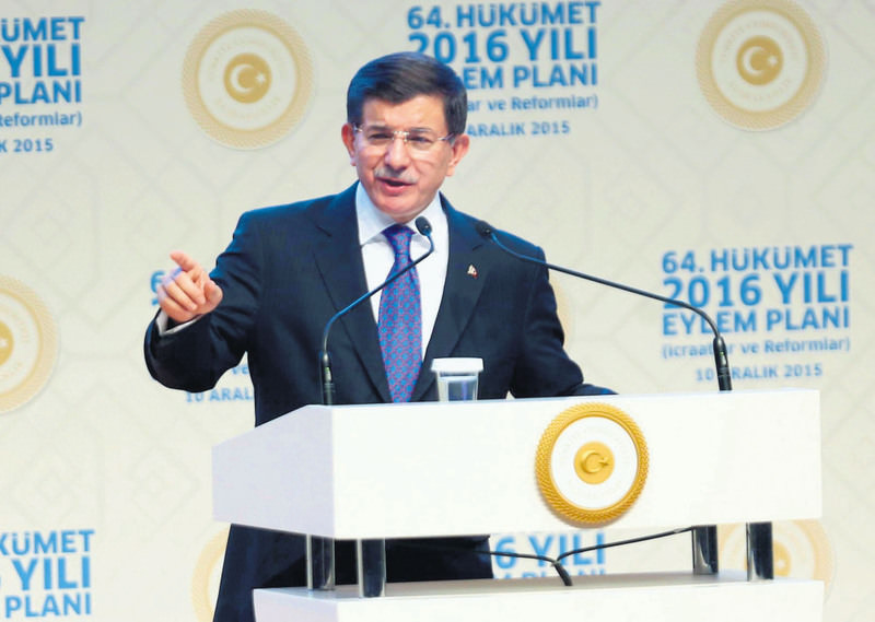 Prime Minister Ahmet Davutoglu delivers a speech during a meeting for the announcement of the 64th government 2016 action plan, at the ATO Congresium in Ankara yesterday.