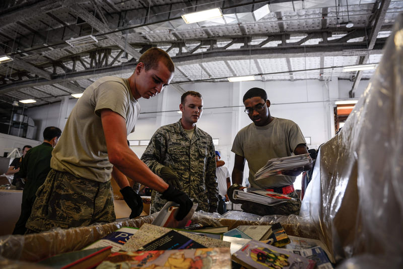 In this Dec. 5, 2015 photo provided by the U.S. Air Force, airmen are packing donated books for Operation Christmas Drop. (AP Photo)