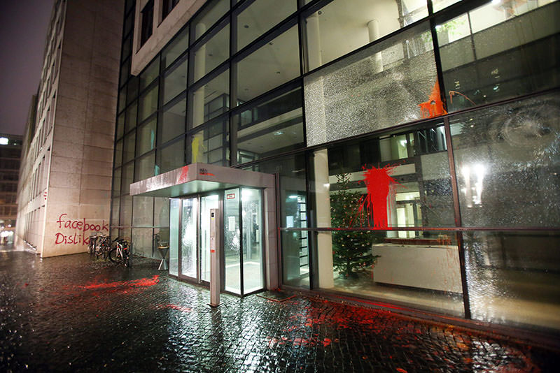 Unknown assailants deface the facade of a building housing the offices of Facebook Germany in Hamburg City (EPA photo)