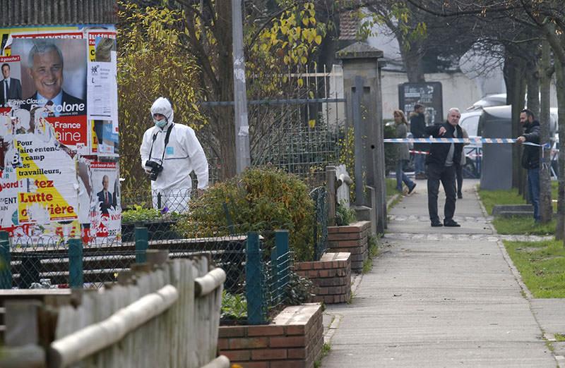 A forensic expert is seen outside Jean-Perrin nursery school in Aubervilliers (AP photo)